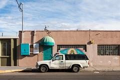 (el zopilote) Tags: albuquerque newmexico street architecture cityscape us66 signs graffiti murals art wheels truck toyota powerlines clouds canon eos 1dsmarkiii canonef24105mmf4lisusm fullframe