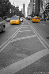 Yellow Cabs on 59th Street, New York 2 (AmbientLens) Tags: 59thstreet bigapple manhattan nyc newyork skyscrapers taxi yellowcab blackandwhite buildings ny selectivecolor yellowtaxi