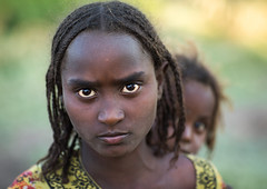 Serious Afar tribe girls, Afar region, Afambo, Ethiopia (Eric Lafforgue) Tags: afambo afar africa african africanethnicity anthropology braidedhair braids child childhood children colourpicture culture danakil day eastafrica ethio17239 ethiopia ethiopian ethiopianethnicity ethnic eyes hair haircut horizontal hornofafrica indigenousculture islam lookingatcamera muslim nomadicpeople outdoors pastoralist people person photography portrait serious todder tradition traditionalclothing traditionalculture tribal tribe twopeople youth afarregion et