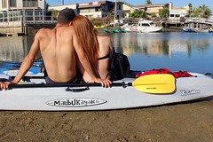 Couple-sitting-on-Tandem-Kayak-X-Caliber-Malibu-Kayaks