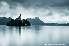 After the rain at Lake Bled (Ian Middleton: Photography) Tags: travel summer vacation mist lake holiday storm mountains reflection building tower history tourism church water beautiful saint architecture clouds religious island scenery europe european bell famous mary scenic eu tourist architectural historic christian slovenia alpine touristy stunning bled former christianity popular yugoslavia assumption attraction shimmering eec slovenian slovene gorenjska slavic