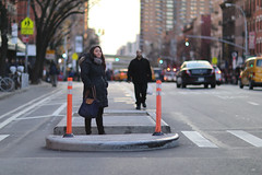 A woman waiting to cross 9th Avenue at 49th Street. (kevinrubin) Tags: newyork unitedstates us