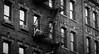 On the break (Janne Räkköläinen) Tags: newyork littleitaly streetphotographing cityview streetview blackwhite smoking tobacco break relax street fire escape ladders art canon canon6d urban katukuvaus