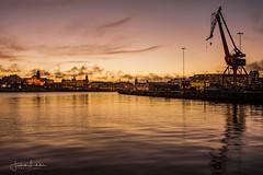 The Iron Giant (Fredrik Lindedal) Tags: cranes harbor gothenburg göteborg visitsweden visitgothenborg morning morninglight water city orange colors clouds sky skyline sweden sverige
