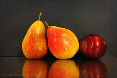 still life - two pears and a plum (uvaisjm - Al Seylani Photography) Tags: stilllife reflection composition pears plum tabletopphotography
