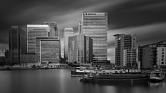 Water Life (Clea Romeo) Tags: canary wharf london long exposure blackandwhite skyscrapers offices buildings boats houseboat