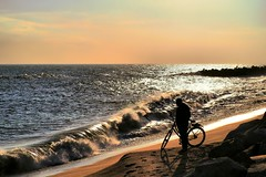 Talking with the waves (explored 2016/12/21) (Fnikos) Tags: sea seaside water waterfront beach shore coast sky skyline sunset seascape landscape people serene wave waves bicycle vehicle outdoor