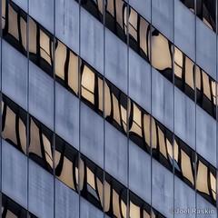 Midtown Facade (Joel Raskin) Tags: facade abstract lines angles patterns mirroredglass reflections reflectiveglass fragmentedreflections fragmented geometric square 11 lumix gx8