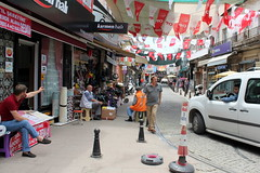 Streets of Ayvalik (overthemoon) Tags: street turkey town traffic trkiye flags turquie trkei lettering bollards bunting ayvalik balikesir shopkeepers presstrip gulfofedremit
