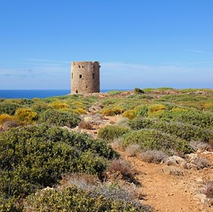 La Torre Spagnola is the oldest tower in Sardinia (Bn) Tags: ocean sardegna blue sea vacation cactus sky italy cliff holiday plant seascape west beach water rock walking landscape island capri drive coast seaside high sand topf50 scenery rocks walks mediterranean italia sardinia torre outdoor hiking wandelen hill lagoon hike cliffs mining formation ridge coastal shore di limestone coastline pan agave viewpoint idyllic unexpected spiaggia height fjords cala thrill bluff formations watercourse domestica crag idyllisch wandelpad 50faves spagnola iglesiente buggerru
