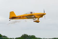 Vans RV-4 during aerobatics show at Holeby Airport (ThomasMaribo) Tags: airplane vans rv4 aerobatics fly plane propeller holeby sport sports show denmark danmark nikon d5300 tamron 70300 70300mm panning yellow airport airstrip aircraft propel flyvemaskine
