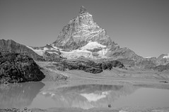 Mighty (Oliver J Davis Photography (ollygringo)) Tags: matterhorn mountain alps switzerland lake tourists hikers small people reflection water ice rock snow europe nature mighty colossal glacier cliff climbing hiking outdoors nikon d90 travel peak summit landscape