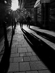 Police activity (heinzkren) Tags: vienna wien austria polizei schatten police shadows street streetfotografie gegenlicht einsatz sicherheit weitwinkel olympus superweiteinkel gehsteig action abendstimmung sonne sun security pflaster pflastersteine shadow operation backlight streife carabinieri sheriff miliz gendarmerienationale blackandwhite bw gendarmerie panasonic lumix srase gehweg trottior trottoir bürgersteig kontrast licht alarm sundown sonnenuntergang policia flic sunset biancoetnero perspektive running sport light silhouette walk uniform gleichschritt