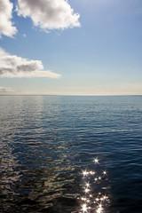 Shimmer on the ocean at Skopunarfjørður, Faroe Islands (thorrisig) Tags: 182014 færeyjar sjór faroeislands thorrisig thorfinnursigurgeirsson thorri þorrisig thorfinnur þorfinnur þorri þorfinnursigurgeirsson sigurgeirsson sigurgeirssonþorfinnur dorres skúvoyarfjørður sea ocan sunshine shimmer glit sjórinn himinn ský skopunarfjørður
