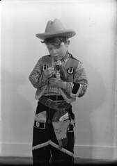 img454 (foundin_a_attic) Tags: glass slides fashion portrait boy cowboy fancy dress custure horseshoe costume hat toy gun hourse