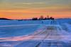 Wintry Road_163960 (rjmonner) Tags: sunset winter snow farm farmland rural barn farming agriculture agricultural agronomic road gravelroad drift drifting driftingsnow wind iowa field fields farmstead jacksoncounty corn cornbelt midwest easterniowa ruralroad rfd