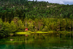 Red hut (Ania Kanabaj) Tags: dalavatnetlake lustrafjorden norway clouds europa fiords forest green hills landscape mountainlake nature redhut sea sky summer sun travel trees trip water waterreflection