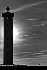 ITALY.2012.Viareggio (nicola fanini) Tags: street people bw lighthouse faro blackwhite streetphotography bianconero biancoenero viareggio nicolafanini