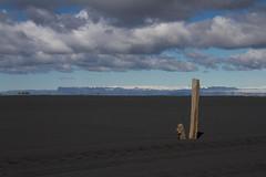 Black Sand Marker (Chris Haigh) Tags: black canon blacksand iceland sand post mirage ísland heathaze ingolfshofdi eos7d chrishaigh