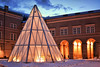 Snow Pyramid (DILLEmma Photography) Tags: pyramid snow sky golden arch white winter bliuehour geometry windows panes architecture glass courtyard yard frontage building roof clouds outdoor