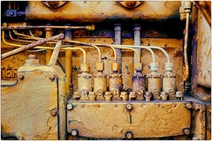 The Art of The Machine (Steve Lundqvist) Tags: motore trasmission gear closeup pistons rust crusty ruggine vintage rusty tractor engine trattore caterpiller macro painted yellow power detail screw tools machine macchina