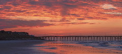 Morning Light (NYRBlue94) Tags: ocean morning pink light red sea sky orange cloud sun seascape color reflection beach water rock clouds sunrise landscape dawn coast early nc sand glow waterfront tide low north shell atlantic shore carolina seashore topsail oceanscape