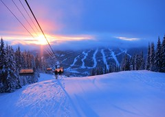 Sunrise over Sun Peaks (Ruth and Dave) Tags: sunpeaks skiresort mountain sunburst todmountain chairlift chair lift snow trees clouds sunrise dawn morning early landscape pistes skiruns weather weatherphotography alpenglow glowing