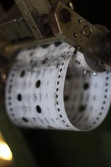 At the weaver's loom (keith bissett) Tags: uk scotland hole unitedkingdom traditional machine lewis scottish holes tape fabric programming program roll sheet rolls harris woven westernisles weaving weave loom hebrides waxed shallowdepthoffield shallowdof harristweed canonslr tweel crofter twill canon50mmlens clothmaking canonprimelens