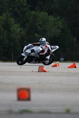 V51A1949 (lgphotoshare) Tags: race speed honda fun outdoor scooter triumph motorcycle sportbike wheelie stunts cbr shoei speedtriple kneedragging 7dmkii ef70200ismkii