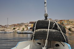 A small boat on Lake Nasser (Thorsten Reiprich) Tags: africa city urban travelling water sunshine spring egypt tire heat tyre  assuan
