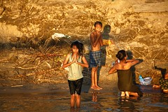 In a land far far away~ Myanmar (~mimo~) Tags: myanmar burma river lake water bathing bath people children documentary boat prayer sunset travel asia shadow