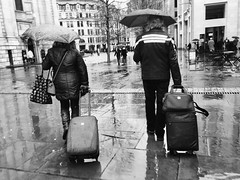 Day 9. Sun seekers. (Rob Emes) Tags: stpauls 2017 365 iphone6 iphoneography iphone bw black mono street urban city london holiday suitcases couple umbrella rainy rain jan2017