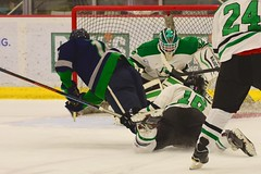 Diving to the goal... (R.A. Killmer) Tags: acha hockey action green white hit goal net goalie fast college mercyhurst sru slippery rock ice skate skater
