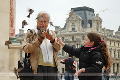 Pigeon Man, Paris, France (Seven Seconds Before Sunrise) Tags: city travel people urban paris france bird girl europe louvre pigeon