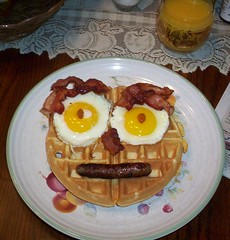 I hate when my breakfast stares at me! (AprilDreams) Tags: face tag3 taggedout breakfast bacon tag2 tag1 sunday sausage eggs lookatme sunnyside waffle interestingness172 i500