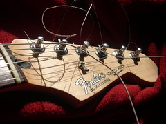 STRAT (mazi_j) Tags: new light shadow red sunlight rock electric silver guitar steel jazz blues mexican fender string rocknroll spagetti standard shape strat install peg macaroni stratocaster bluesteel electricguitar mazi