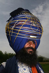 Nihang Singh with Big Turban (Captain Suresh Sharma) Tags: travel blue india holiday heritage religious soldier big asia unique decoration culture crest special holy warrior turban sikh punjab amritsar baba bold punjabi decorated singh sardar panjabi headgear beeds panjab nihang punjanb longcloth bigturban nihangbaba beedsonturban heavyturban openbeared