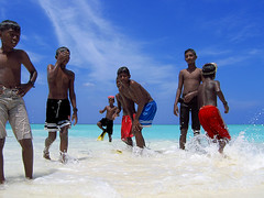 Powerful Primaries (Ahmed Zahid) Tags: travel boy sea sun island interestingness play power push top10 splash maldives primary limits ahmedzahid view2000 funlife