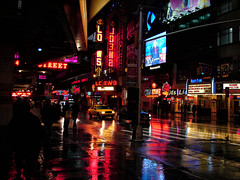 [2005] West 42nd Street... (Diego3336) Tags: street nyc urban usa signs ny newyork reflection wet colors rain night america lowlight theater neon nightshot manhattan cab taxi broadway rainy timessquare loews taxicab streetshot theaterdistrict