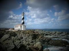 favaritx  ( menorca ) (Ivan Serra) Tags: espaa lighthouse clouds faro islands mar spain mediterraneo sunny playa nubes far islas menorca baleares minorca nuvols balearic balears mediterraneum illes favaritx top20lh notafinal8 ltytr1