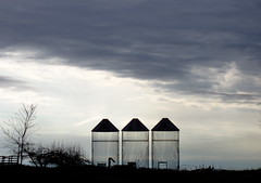 3 in a row (oldbrushes) Tags: sky field silhouette rural america bravo pattern dusk michigan farm grandrapids wayland naturescenes calendarshots cornbins easternnorthamericanature newphotographers abigfave bonzag p1f1 anawesomeshot