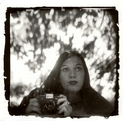 Me With My HOLGA (on 4th Street) (stOOpidgErL) Tags: camera trees blackandwhite bw selfportrait reflection film me girl face female analog self myself square outdoors mirror holga photographer bokeh toycamera piercing identity lipring selfreflection fullframe agfa 4thstreet identitycrisis plasticcamera myface crappycamera mpd lippiercing holgacamera backgroundblur silvergelatinprint stoopidgerl sloppyborders mewithmyholga multiplepersonalitydisorderproject mulitplepersonalitydisorder reflection|noitcelfer