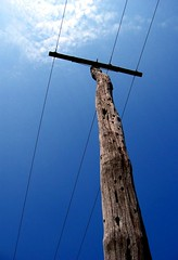 pole (joaobambu) Tags: wood blue brazil sky azul brasil rural countryside post 2006 cu pole wires cielo electricity ceu ruraldecay