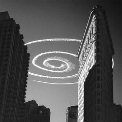 NYC, 1995 (idogu) Tags: street nyc friends light shadow blackandwhite bw newyork building art airplane real spiral this is insane topv333 contrail manhattan no it again topv777 but isreal really shape 31 ori