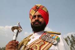 Army Band Conductor of the Sikh Battalion, Indian Army (Captain Suresh Sharma) Tags: red india soldier costume fighter martial handsome leader turban sikh punjab ethnic punjabi medals decorated headgear teamleader conductore sikhsoldier photographybycaptsureshsharma sikhsoldieroftheindianarmy imagesofsikhsinceremonialdress medalsoftheindianarmy indianarmysoldier photosofsikhsoldiers sikssoldierwithmedalsonhischest bandconductorofthemilitarybandoftheindianarmy