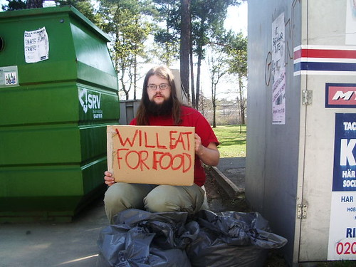 Photo of guy with sign saying will eat for food