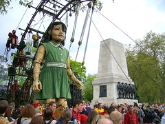 Le Petit Gant (steeev) Tags: uk carnival london girl giant robot doll puppet parade robots huge gigantic warmemorial robotics animatronics marionette giantess puppetry warmonument spectacle littlegiant streettheatre steeev royaldeluxe sultanselephant thesultanselephant thelittlegiant lepetitgant thesmallgiant smallgiant