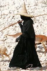 Veiled woman with high hat keeping goats - Haramawt Yemen (Eric Lafforgue) Tags: hat republic arabic arabia yemen arabian ramadan yemeni yaman arabie yemenia jemen lafforgue arabiafelix  arabieheureuse  arabianpeninsula hadramout ericlafforgue iemen lafforguemaccom mytripsmypics imen imen yemni    jemenas    wwwericlafforguecom  alyaman ericlafforguecomericlafforgue contactlafforguemaccom yemenpicture yemenpictures  haramawt