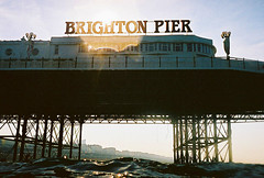 brighton pier (lomokev) Tags: sea summer water silhouette sign sport swimming swim pier brighton type brightonpier palacepier deletetag nikonosv nikonos5 filecnv00060