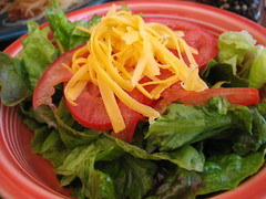 Salad with tomatoes and grated cheddar cheese